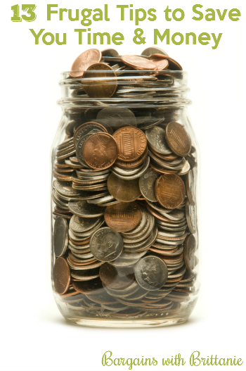 Glass jar almost overflowing with American coins against a white background