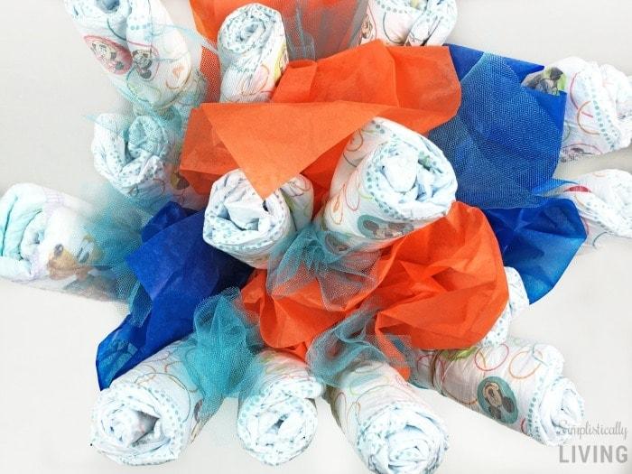 DIY Diaper Bouquet #diaper #diaperbouquet #babyshower #babyshowergifts #diapercake