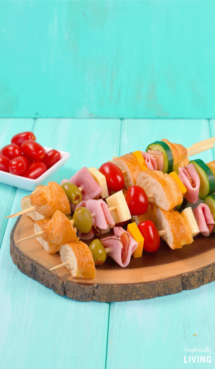 ham and cheese skewers on plate