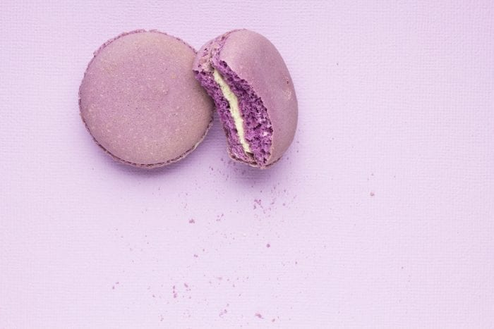 lavender macarons with bite taken out of them