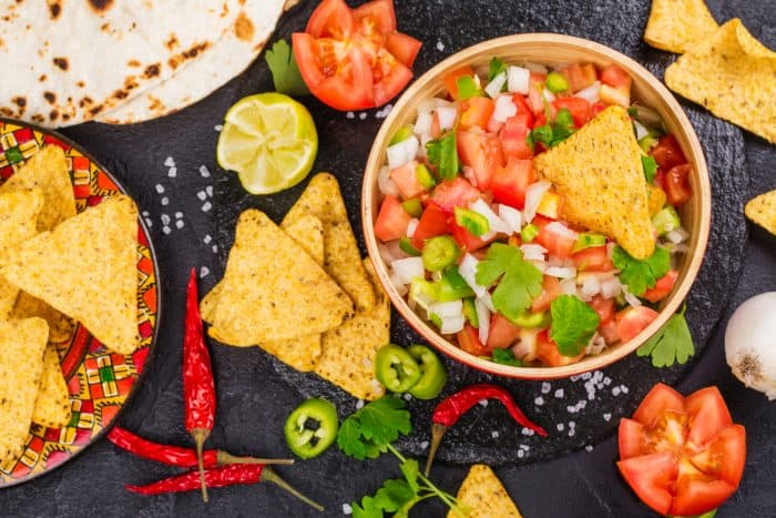 This Easy Pico de Gallo Recipe can be made in just a few minutes using fresh tomatoes, onion, peppers, garlic, cilantro, lime and lemon. It adds the perfect amount of flavor and kick to any dish!