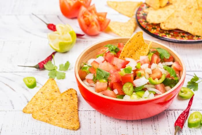 Easy Pico de Gallo Recipe - This Easy Pico de Gallo Recipe can be made in just a few minutes using fresh tomatoes, onion, peppers, garlic, cilantro, lime and lemon. It adds the perfect amount of flavor and kick to any dish!