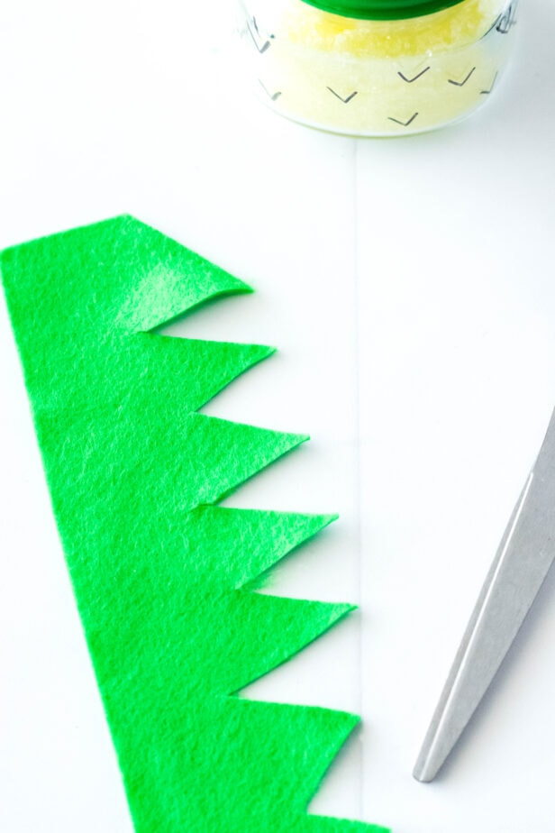picture of green felt cut into a zig zag with scissors