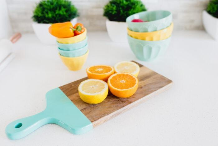 freshly cut oranges on a cutting board