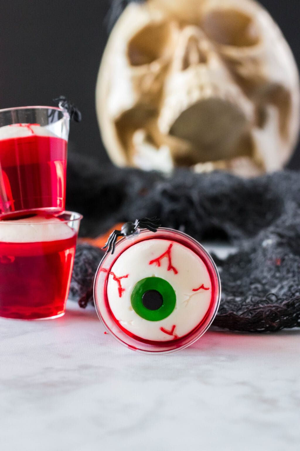 upclose photo of a red jello shot with gummy eyeball