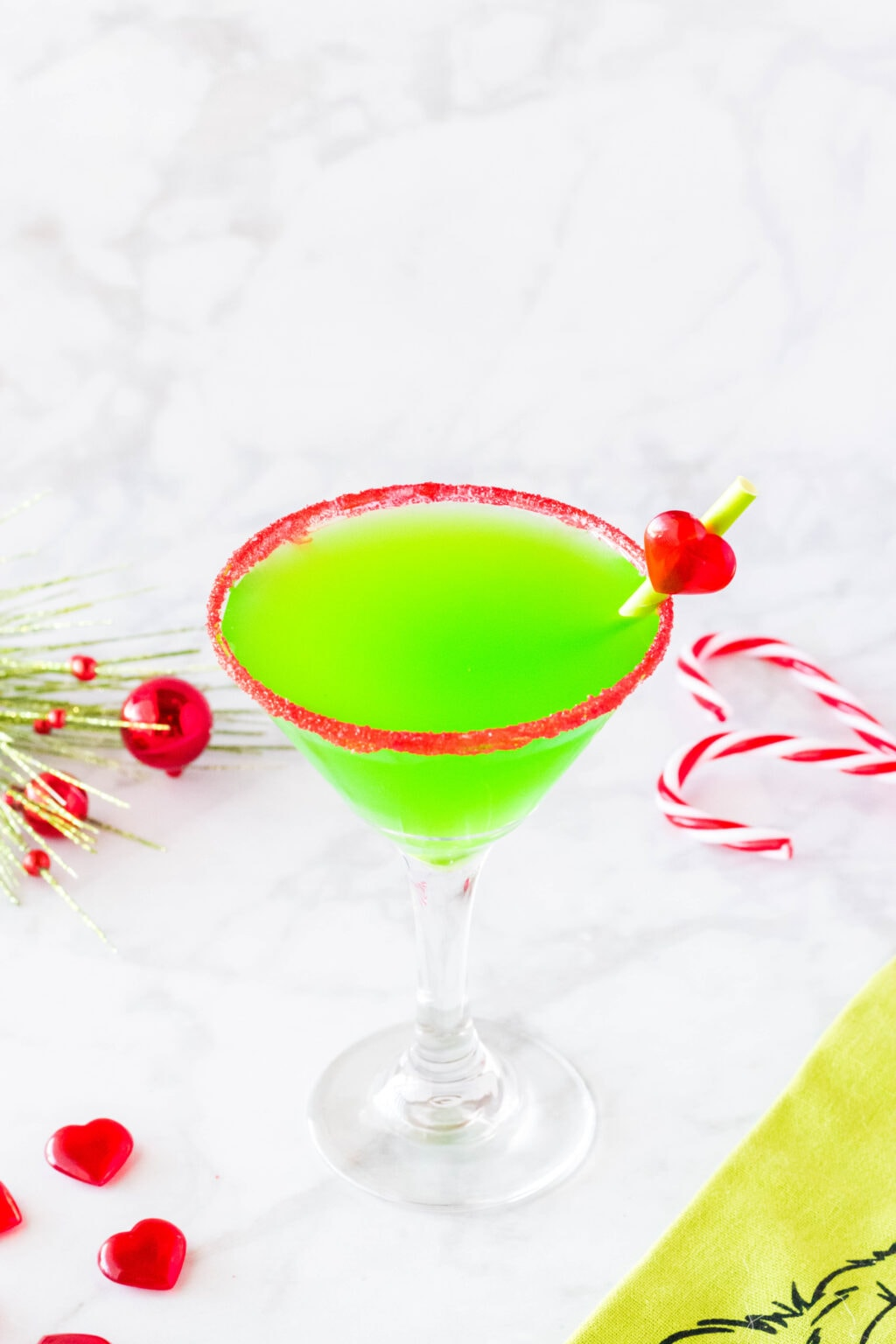grinch cocktail with stirrer in glass