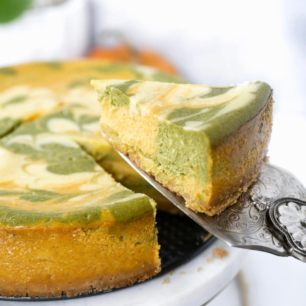 slice of matcha pumpkin cheesecake being served