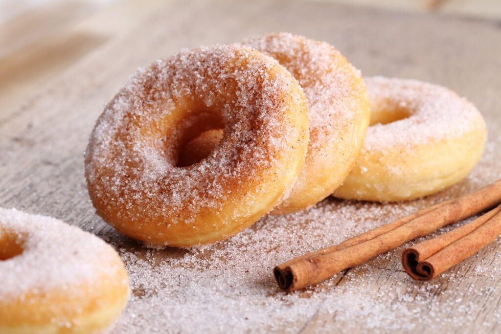 upclose cinnamon sugar donuts on a table