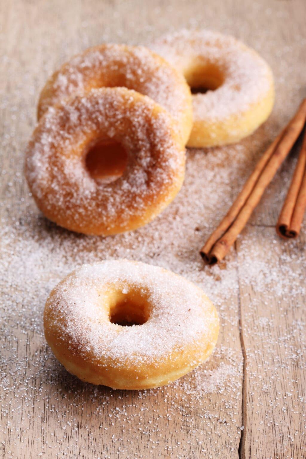 cinnamon sugar donuts on a table