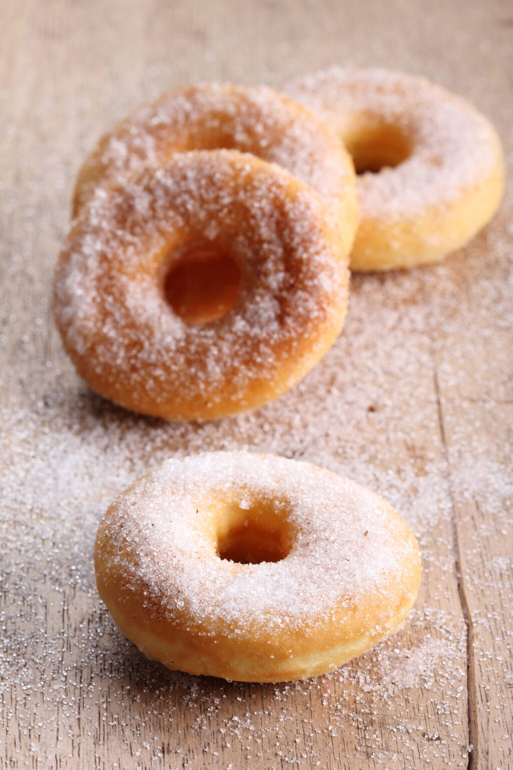 canned biscuit donuts covered in cinnamon and sugar