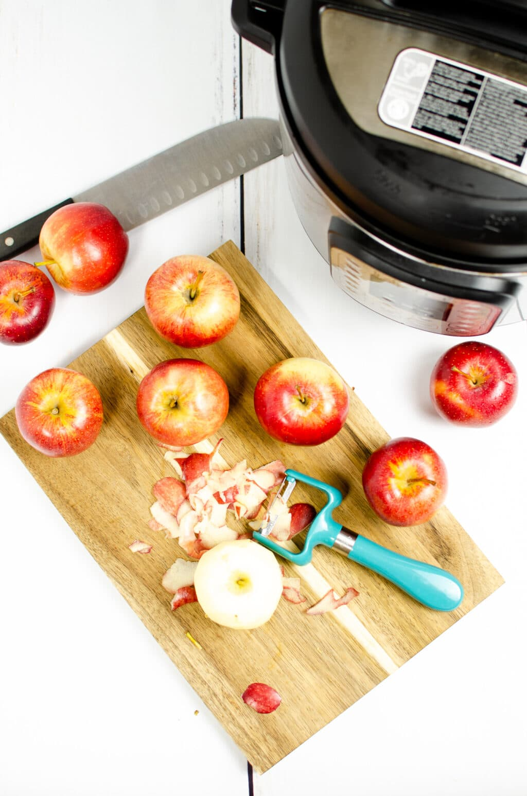 apples on a cutting board being peeled