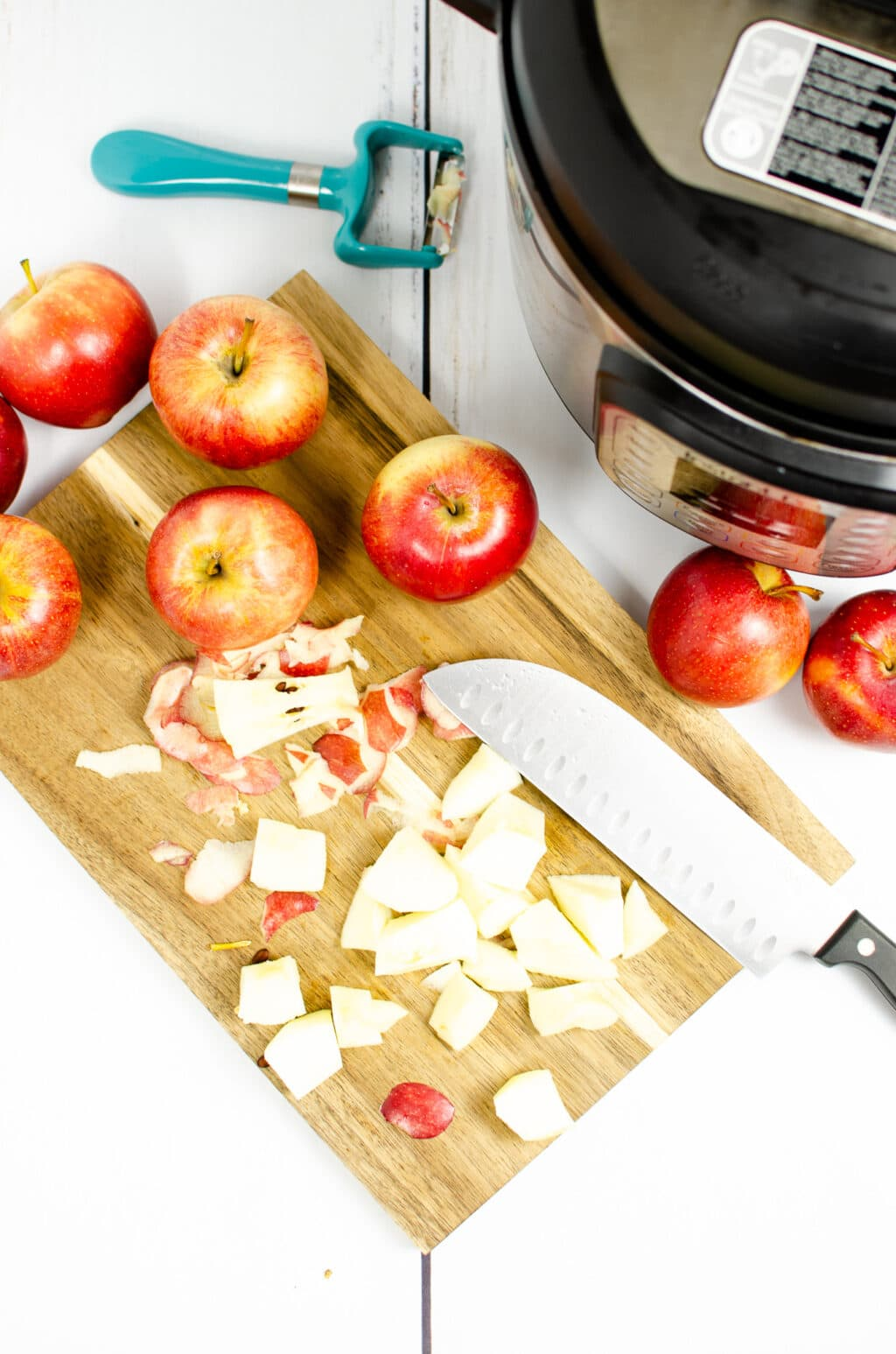 apples on a cutting board being cut into cubes