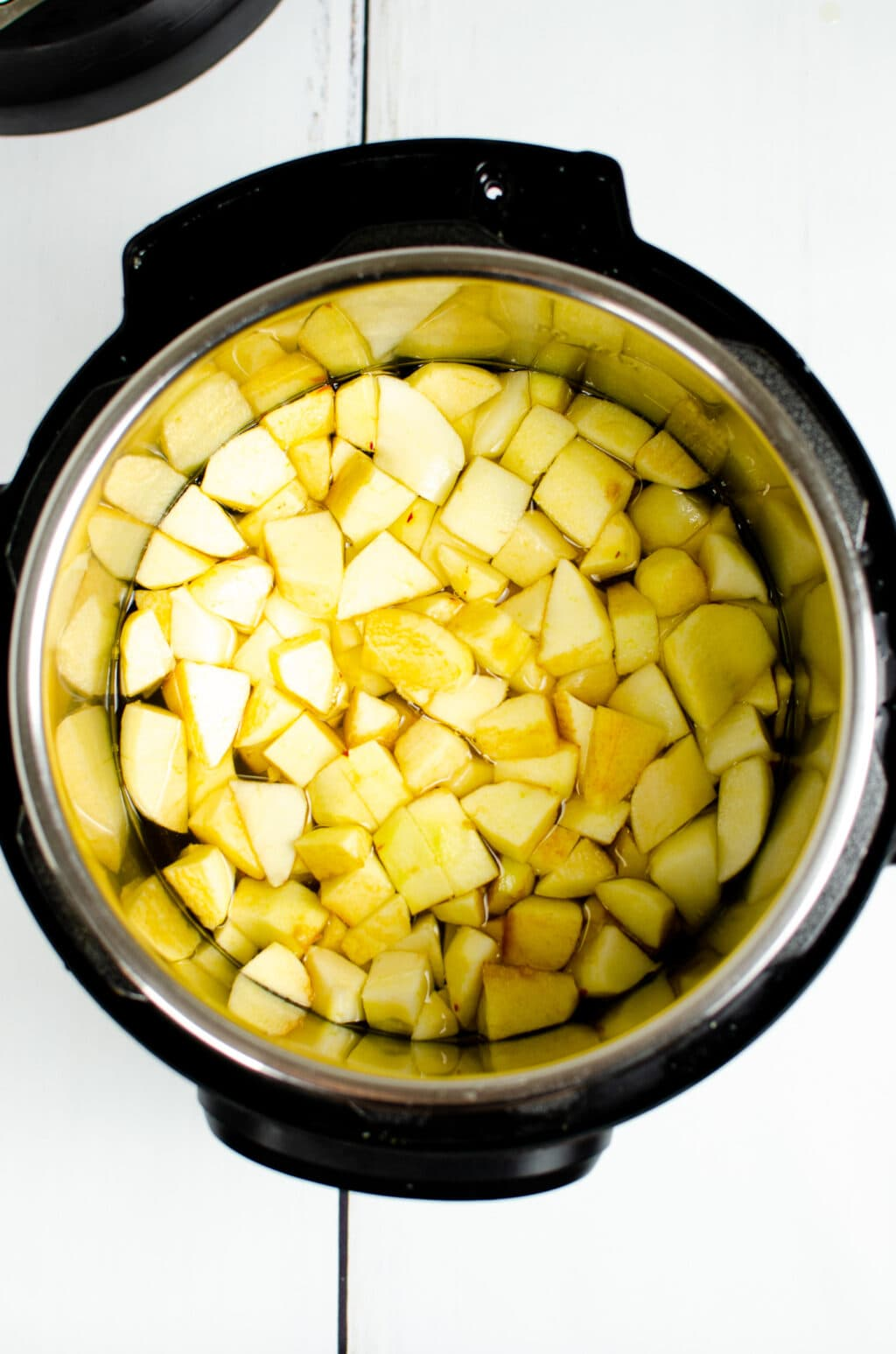 cut apple pieces in water inside an Instant Pot