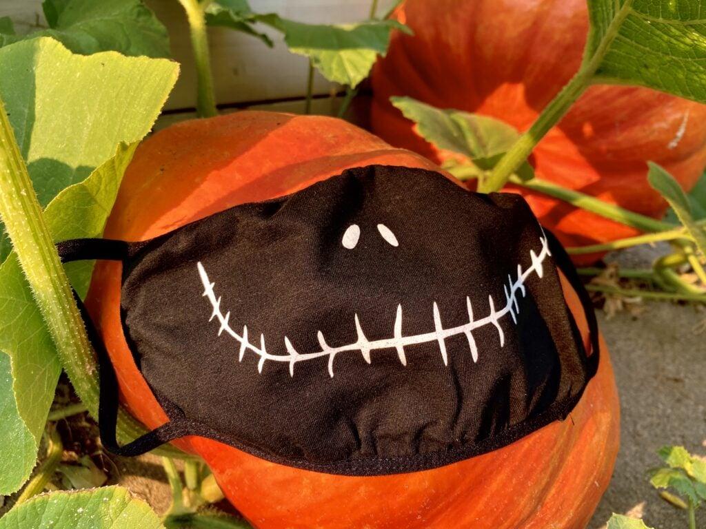 jack skellington face mask on a pumpkin