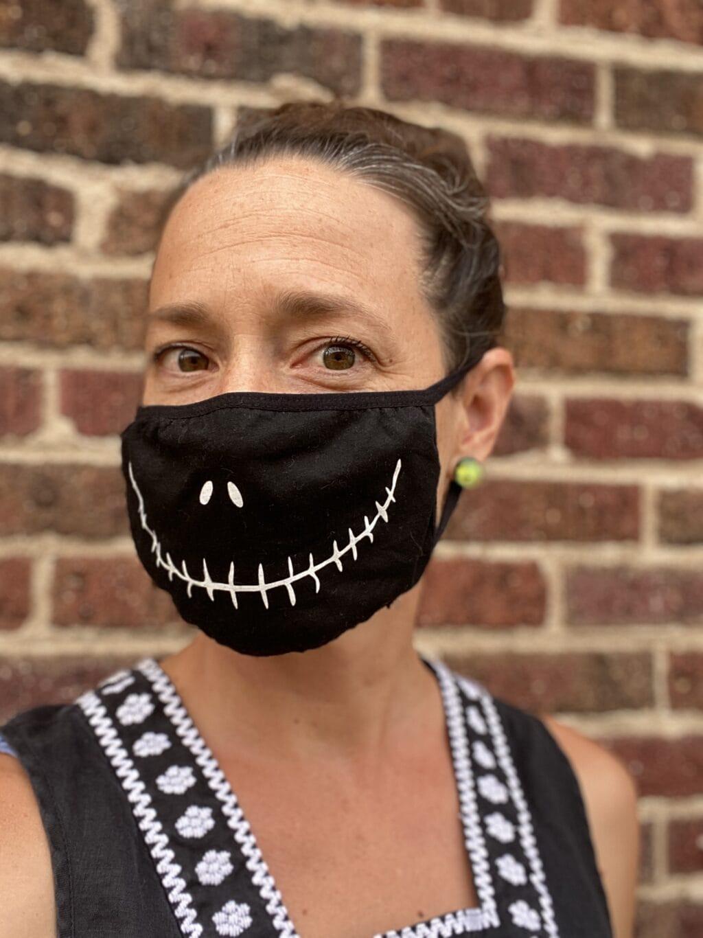 woman wearing a jack skellington face mask