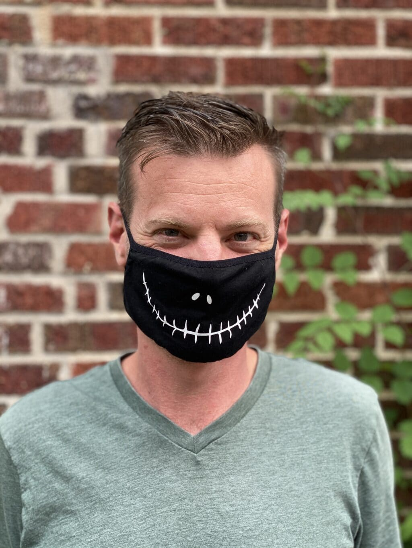 man wearing a jack skellington face mask