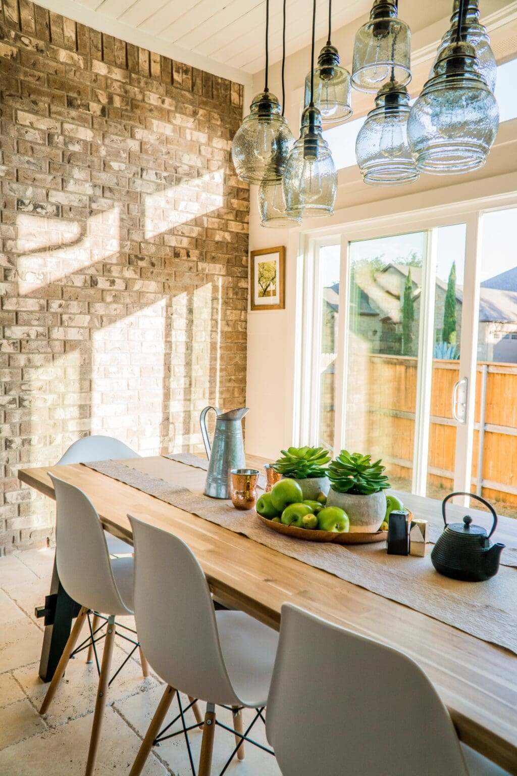 sun shining through patio window onto a dining room table