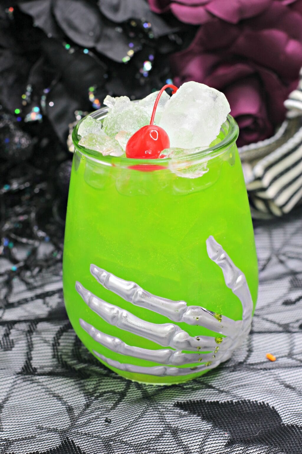 Green Halloween cocktail in a skeleton glass