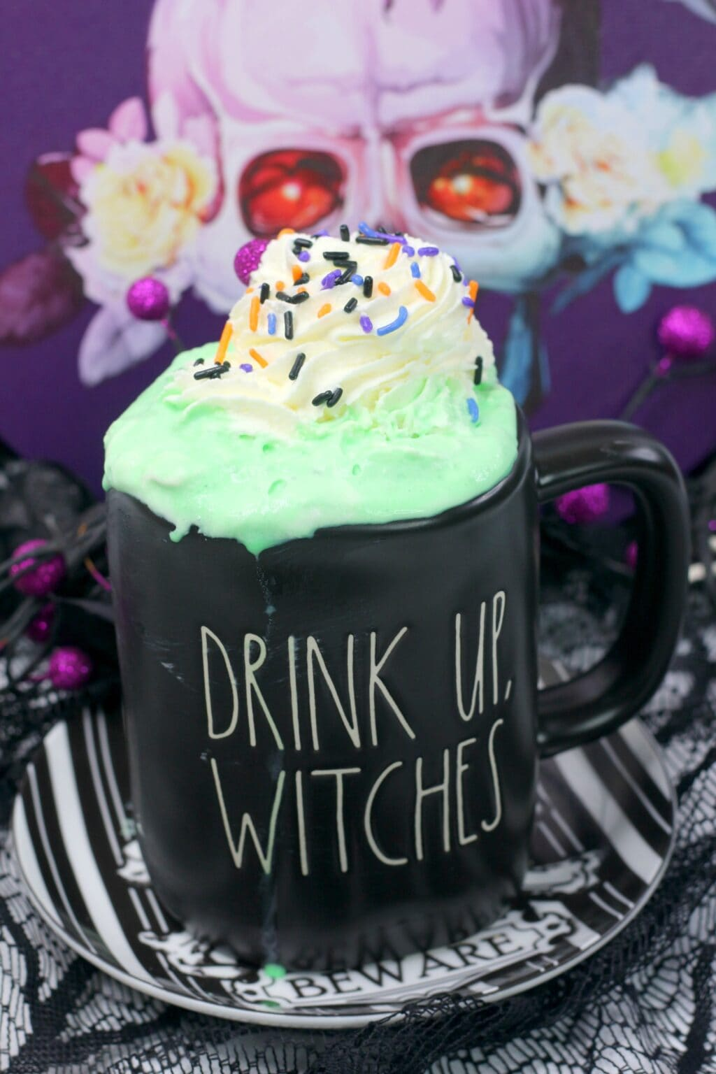 "Hocus Pocus hot cocoa in a Rae Dunn Halloween mug that says ""Drink Up, Witches"""