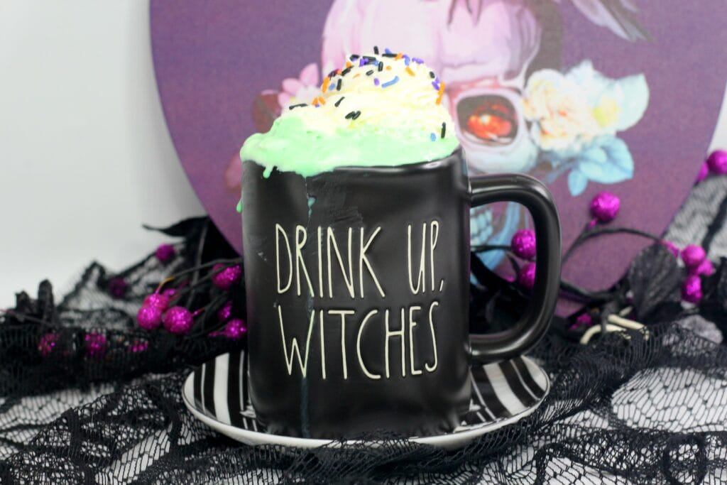 "Rae Dunn Halloween mug that says ""Drink Up, Witches"" filled with Hocus Pocus Hot Cocoa"