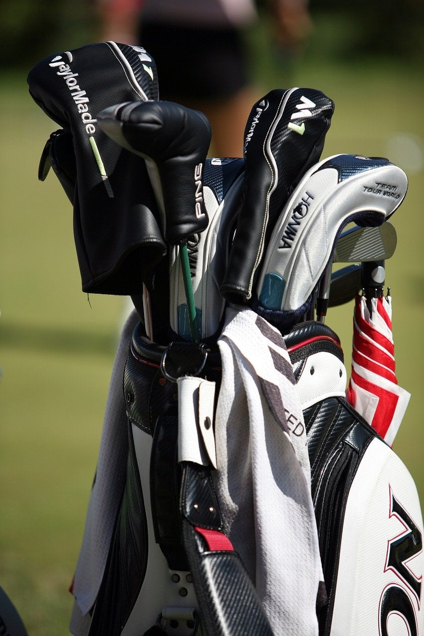 golf bag filled with golf gear