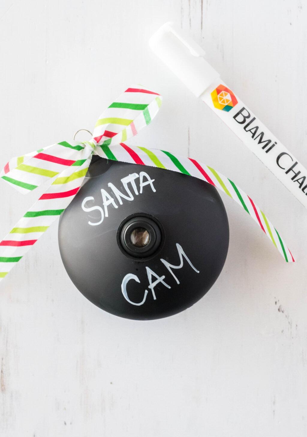black ornament that says Santa Cam on it