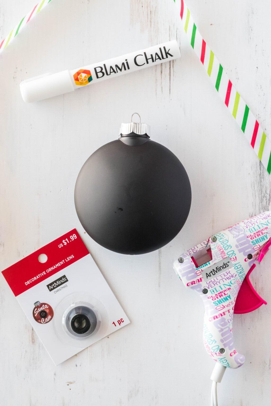 santa cam ornament supplies on table