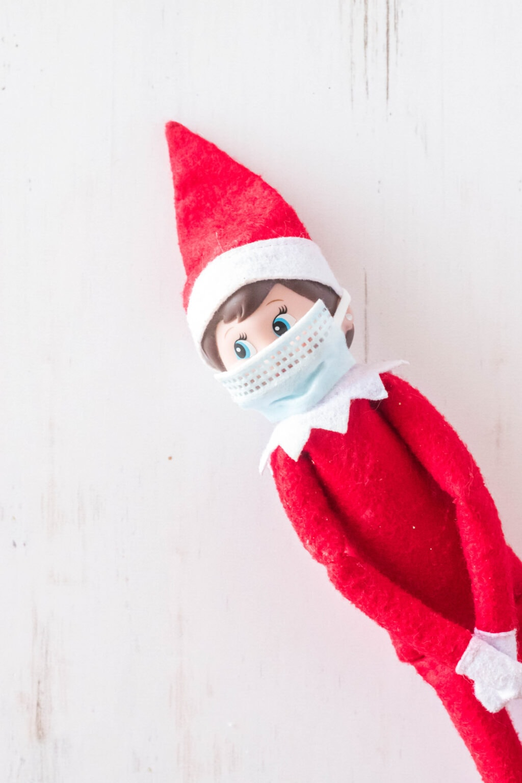 elf on the shelf wearing a mask