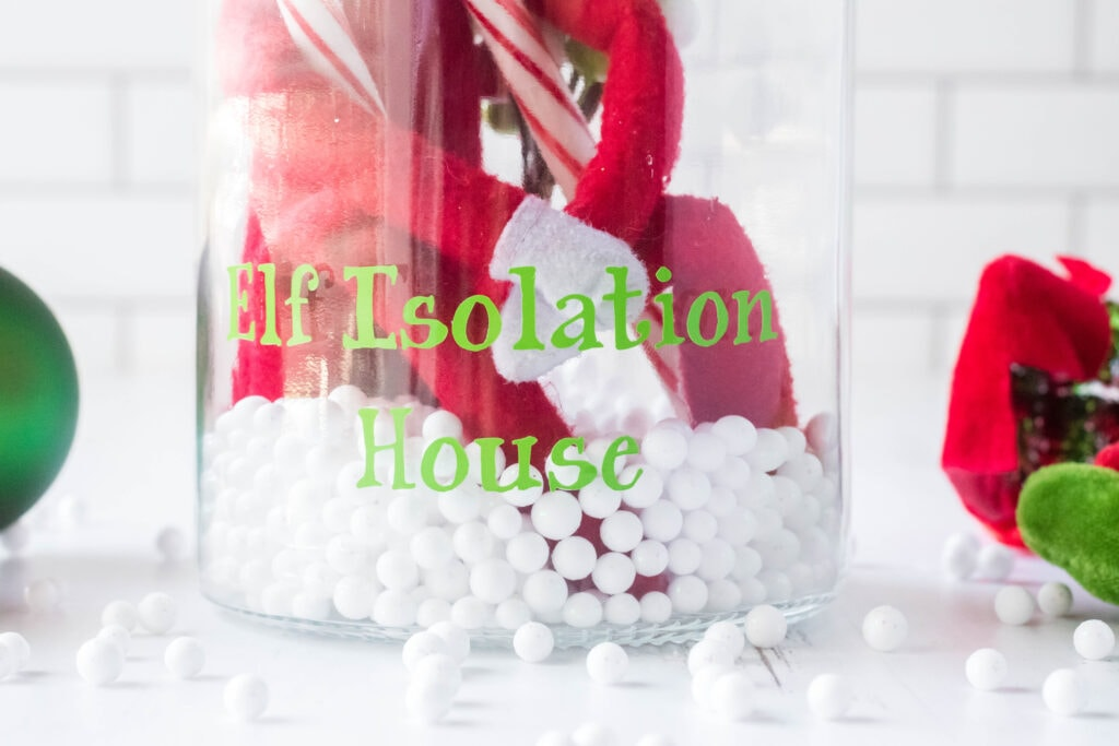 jar with words that say elf isolation house