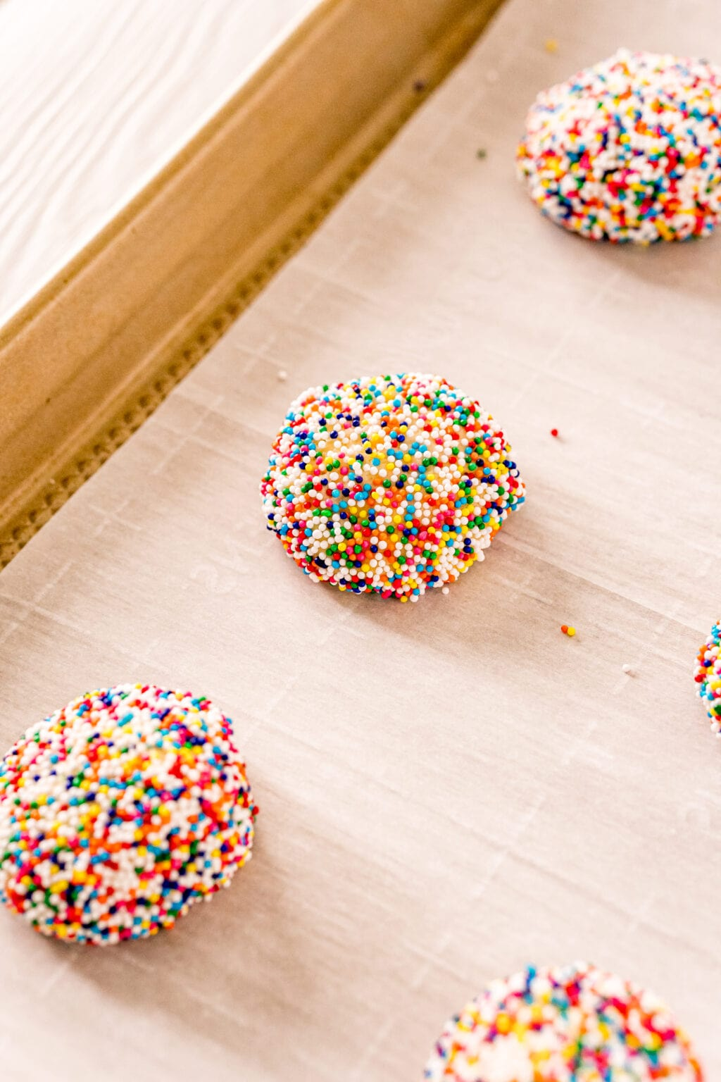 cookie dough covered in rainbow sprinkles