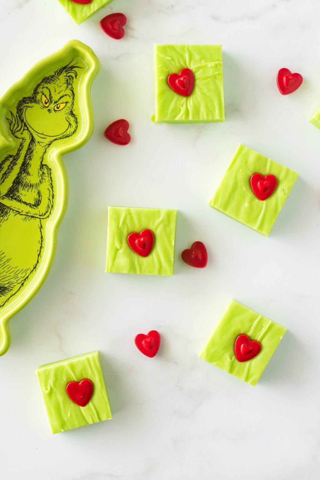 grinch fudge pieces spread on table