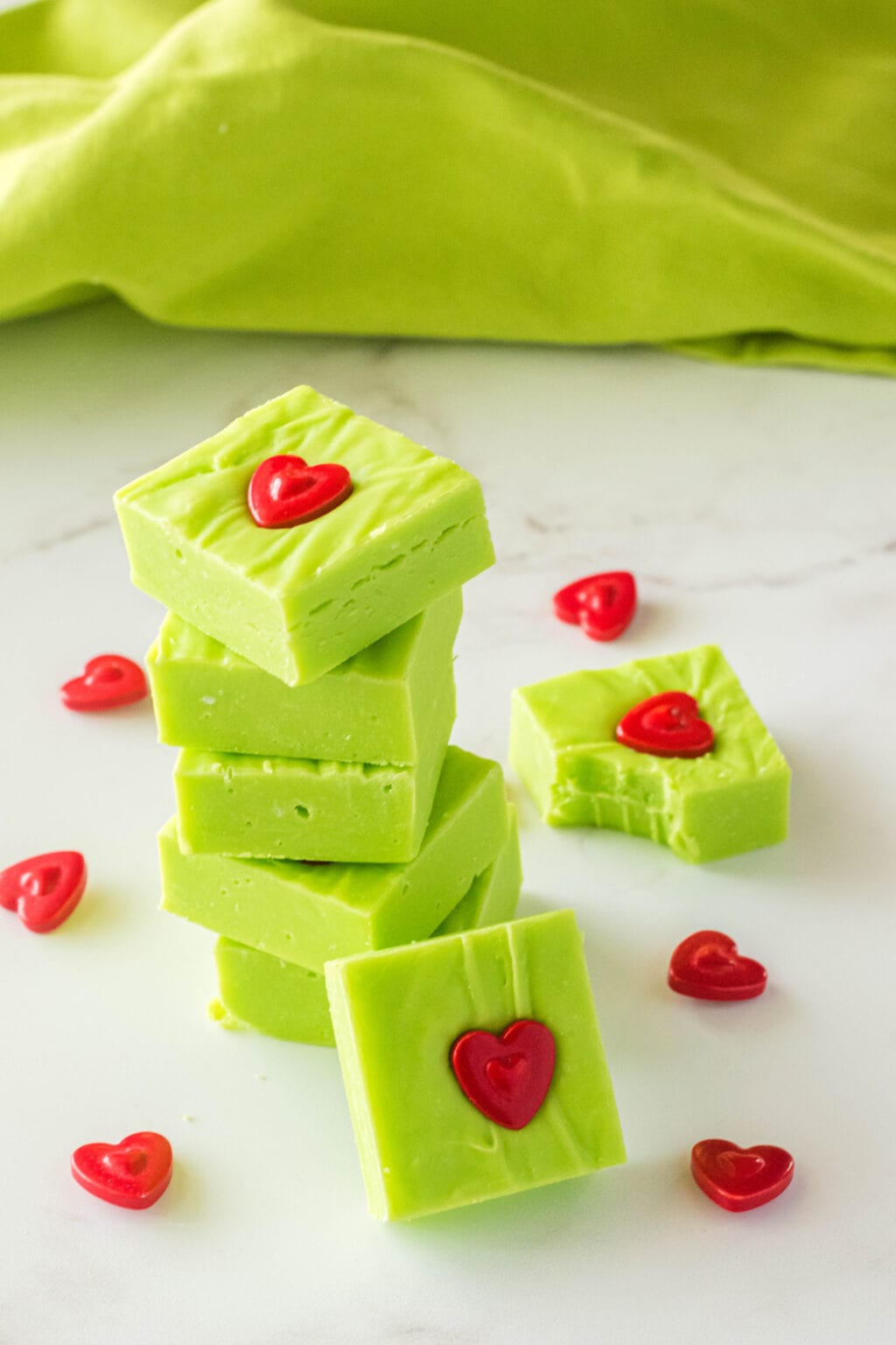 grinch fudge pieces stacked on a table