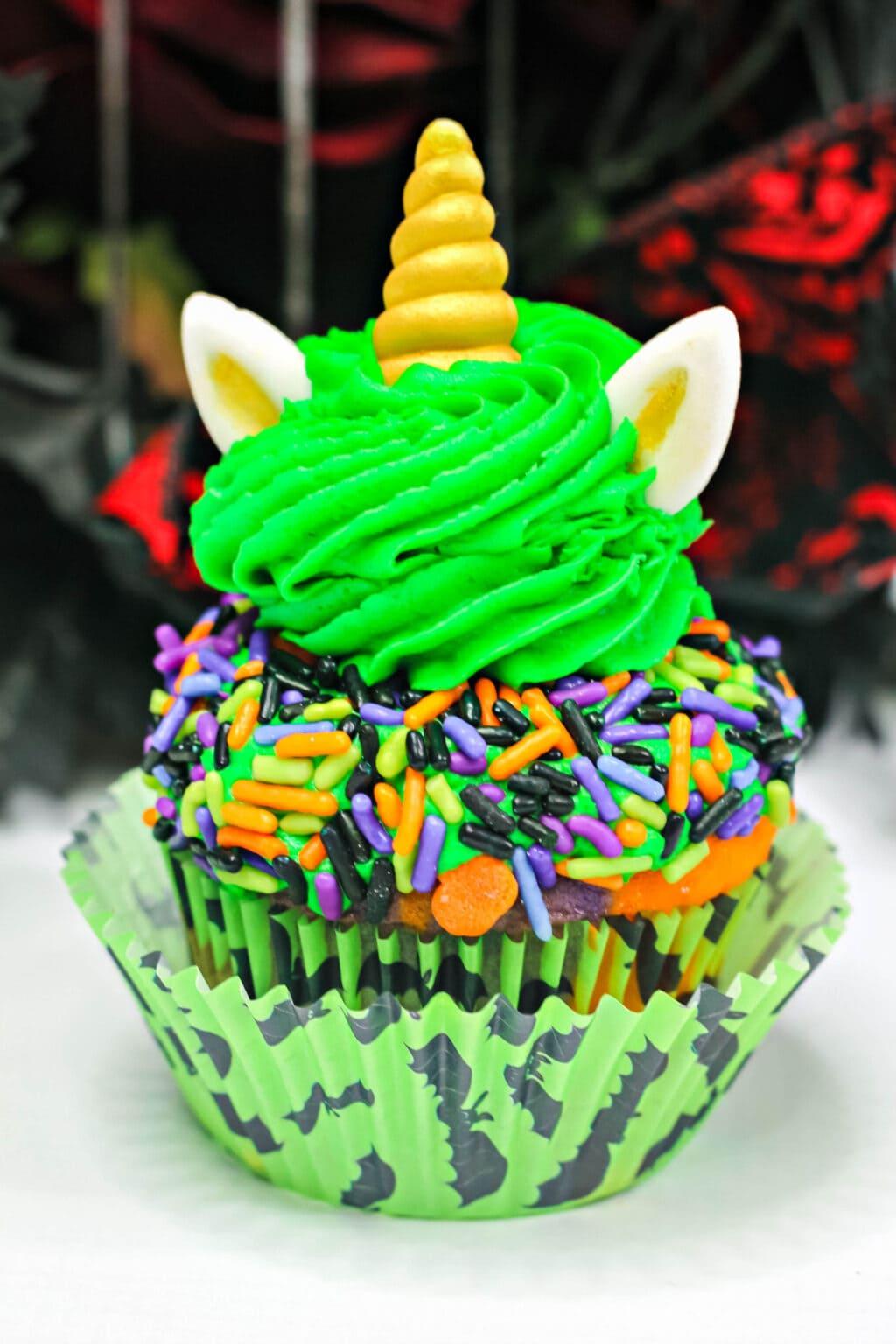 halloween unicorn cupcake on table
