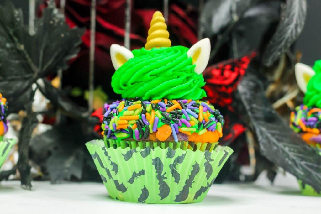 unicorn Halloween cupcake covered in sprinkles