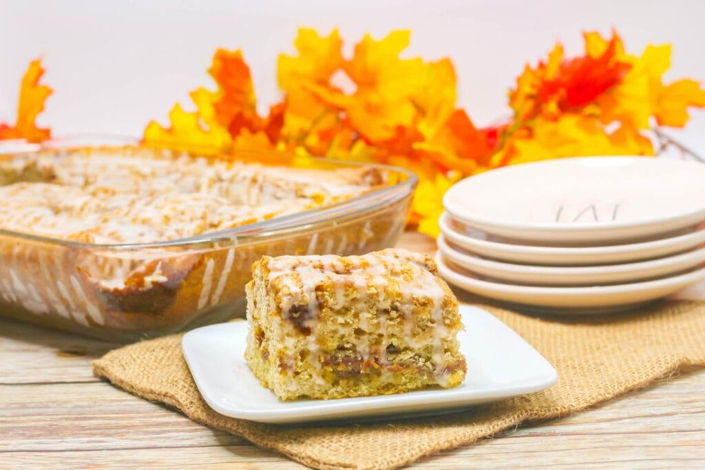 pumpkin cinnamon roll cake slice on a plate