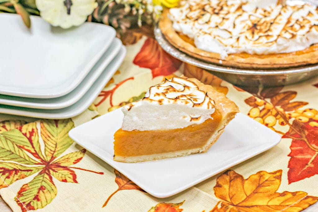 sweet potato pie on a plate with pie in the background
