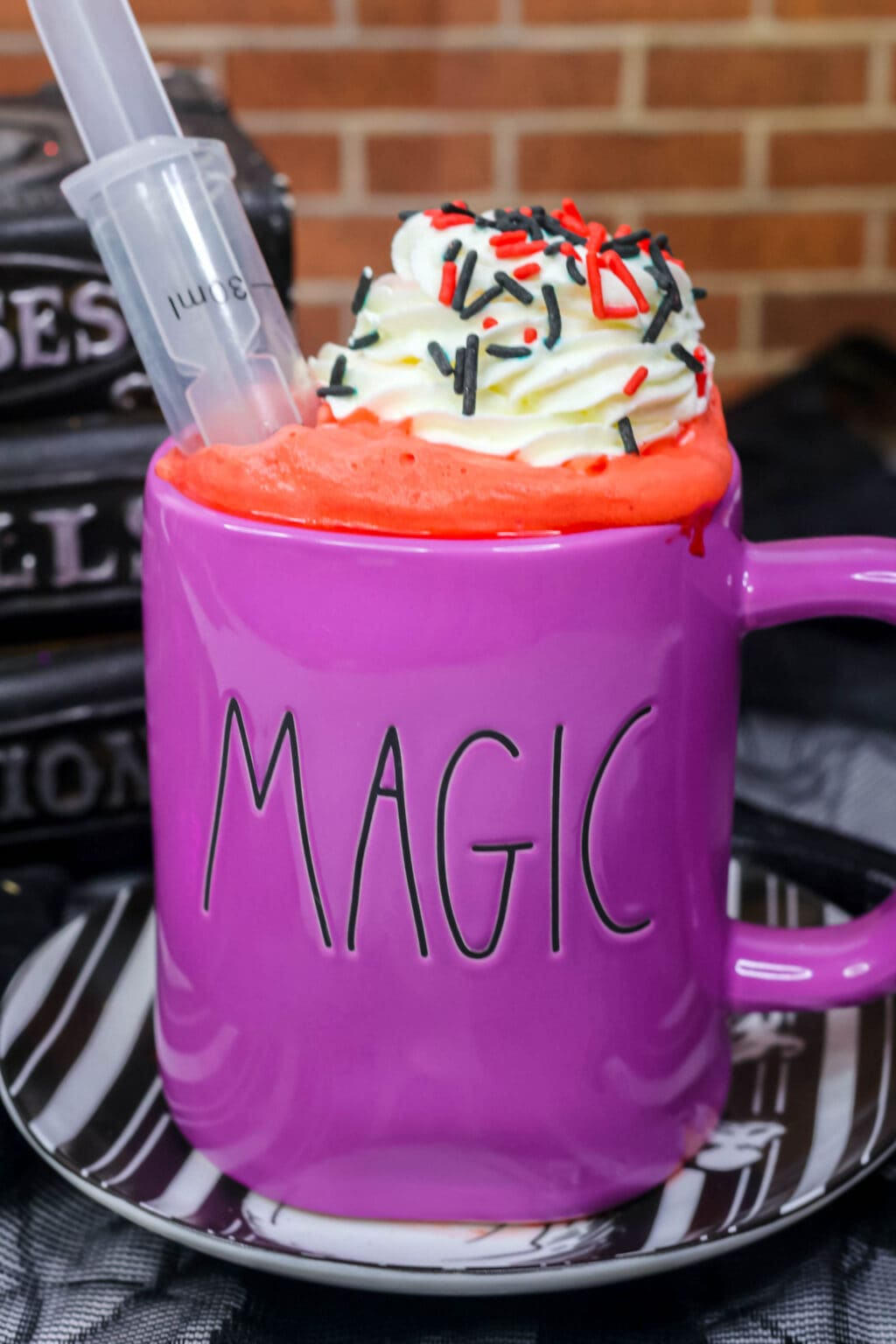 "vampire hot cocoa inside a mug that says ""magic"" on the front"