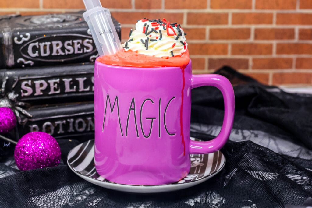 vampire hot cocoa in a purple mug that says magic