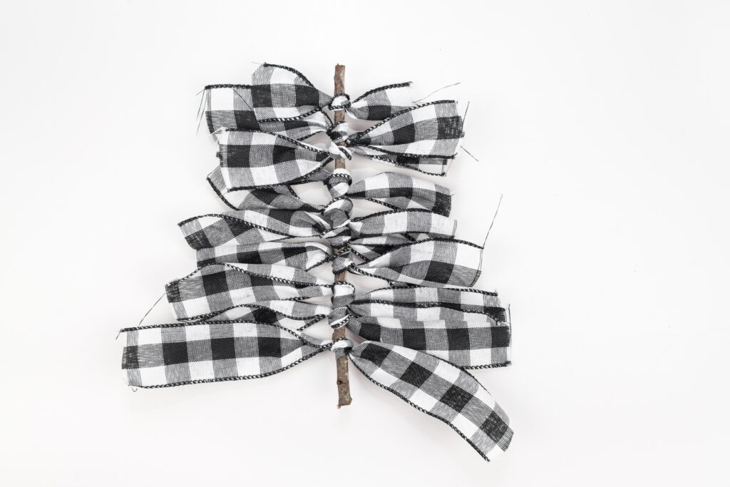 Buffalo Plaid Ribbon Tree Ornament ribbon tied around twig