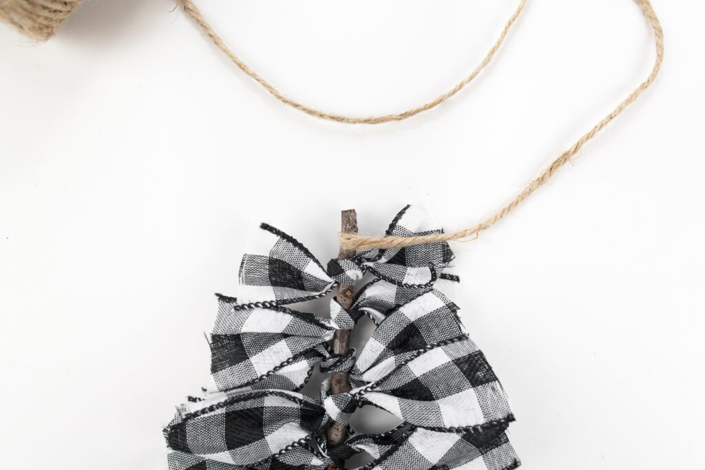 twine wrapped around top of Buffalo Plaid Ribbon Tree Ornament