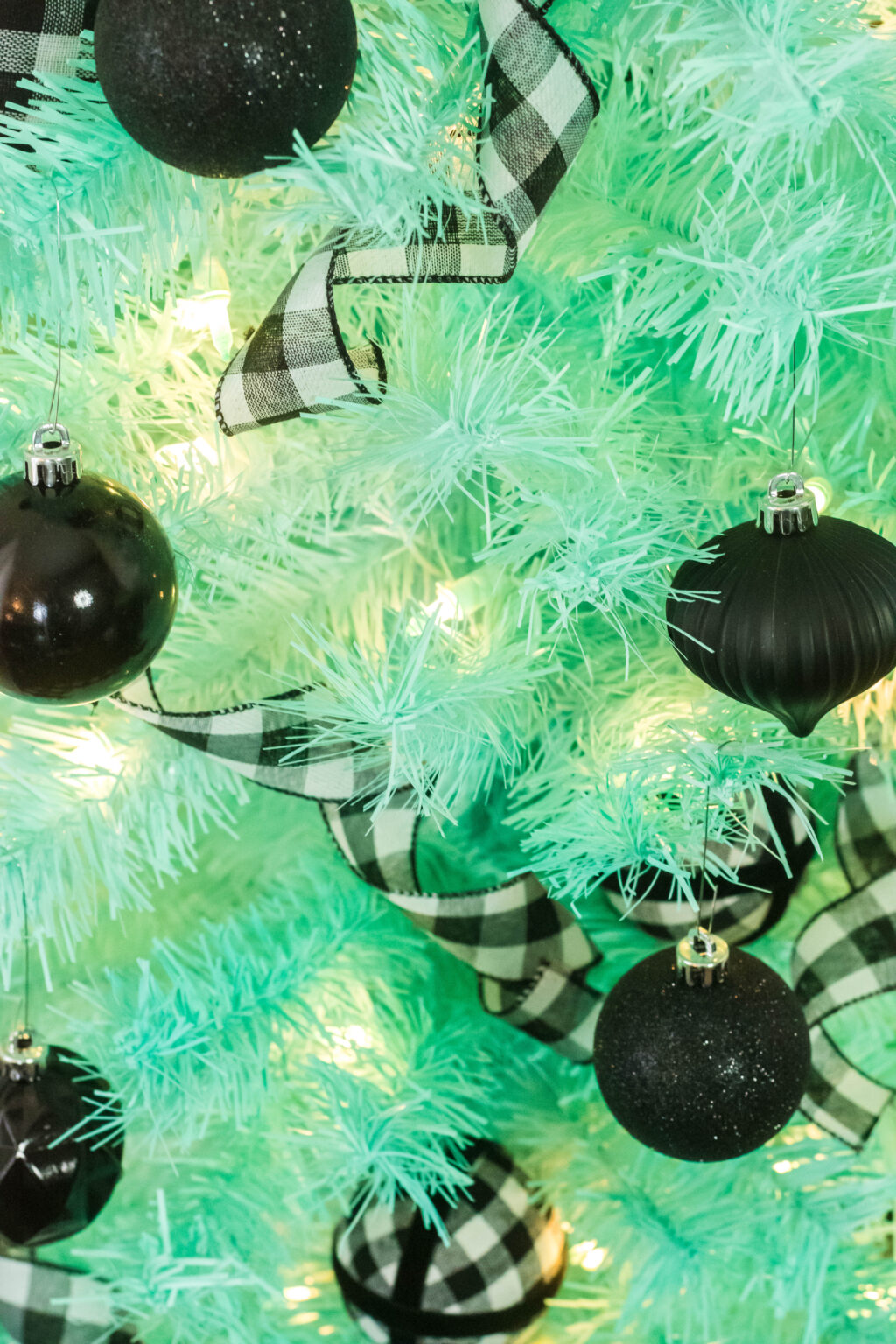 mint christmas tree with black christmas tree decorations