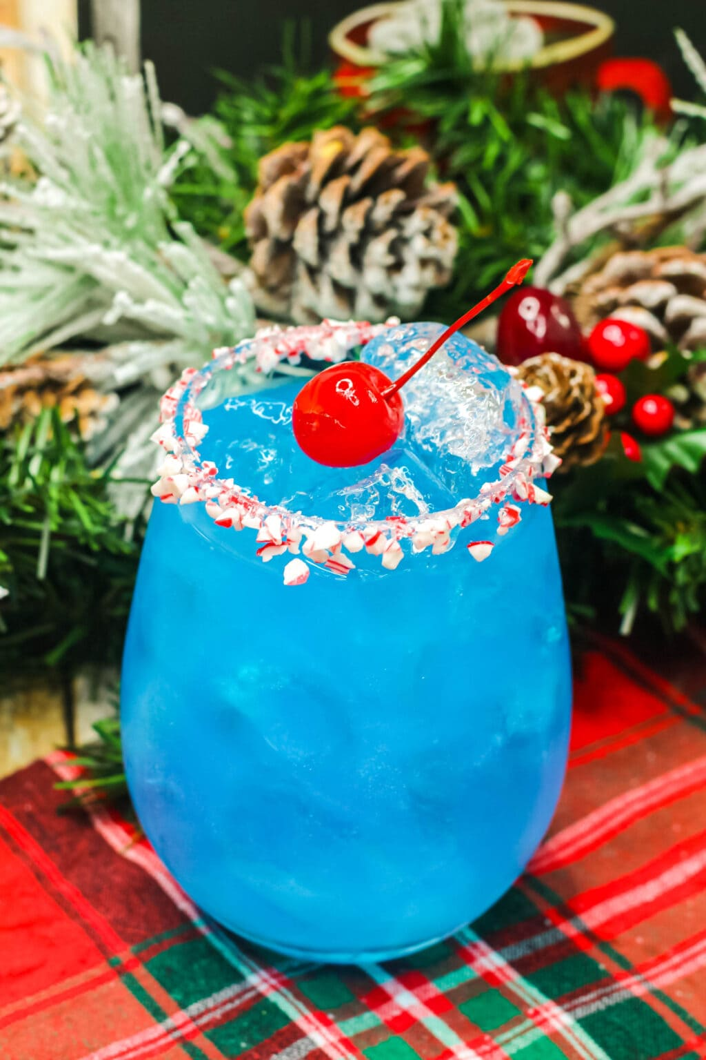 blue frosty cocktail in a glass with ice