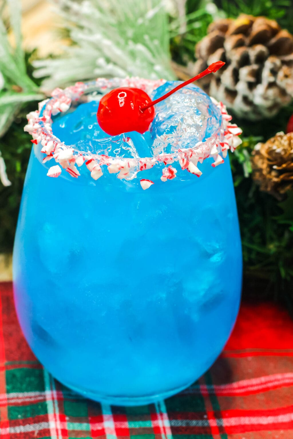 frosty cocktail in a glass with cherry on top