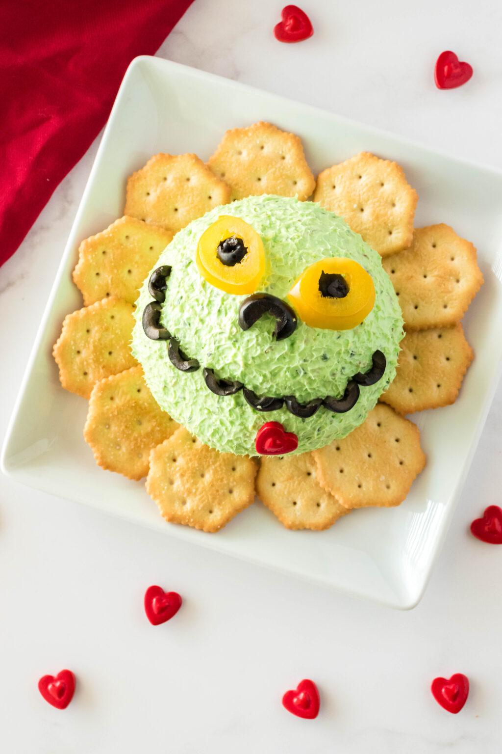 grinch cheese ball on a plate