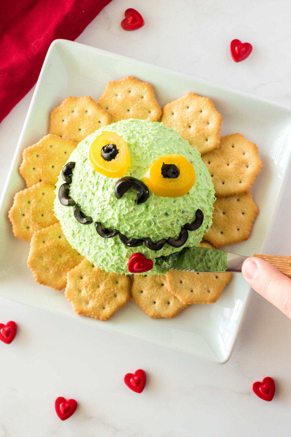 grinch cheese ball on serving plate