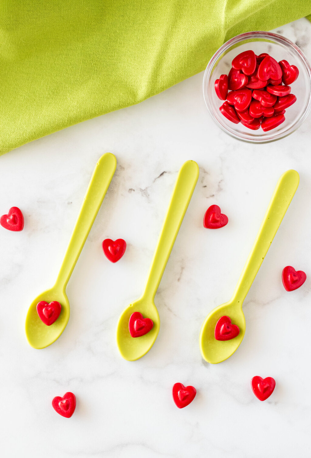 grinch hot chocolate spoons on table