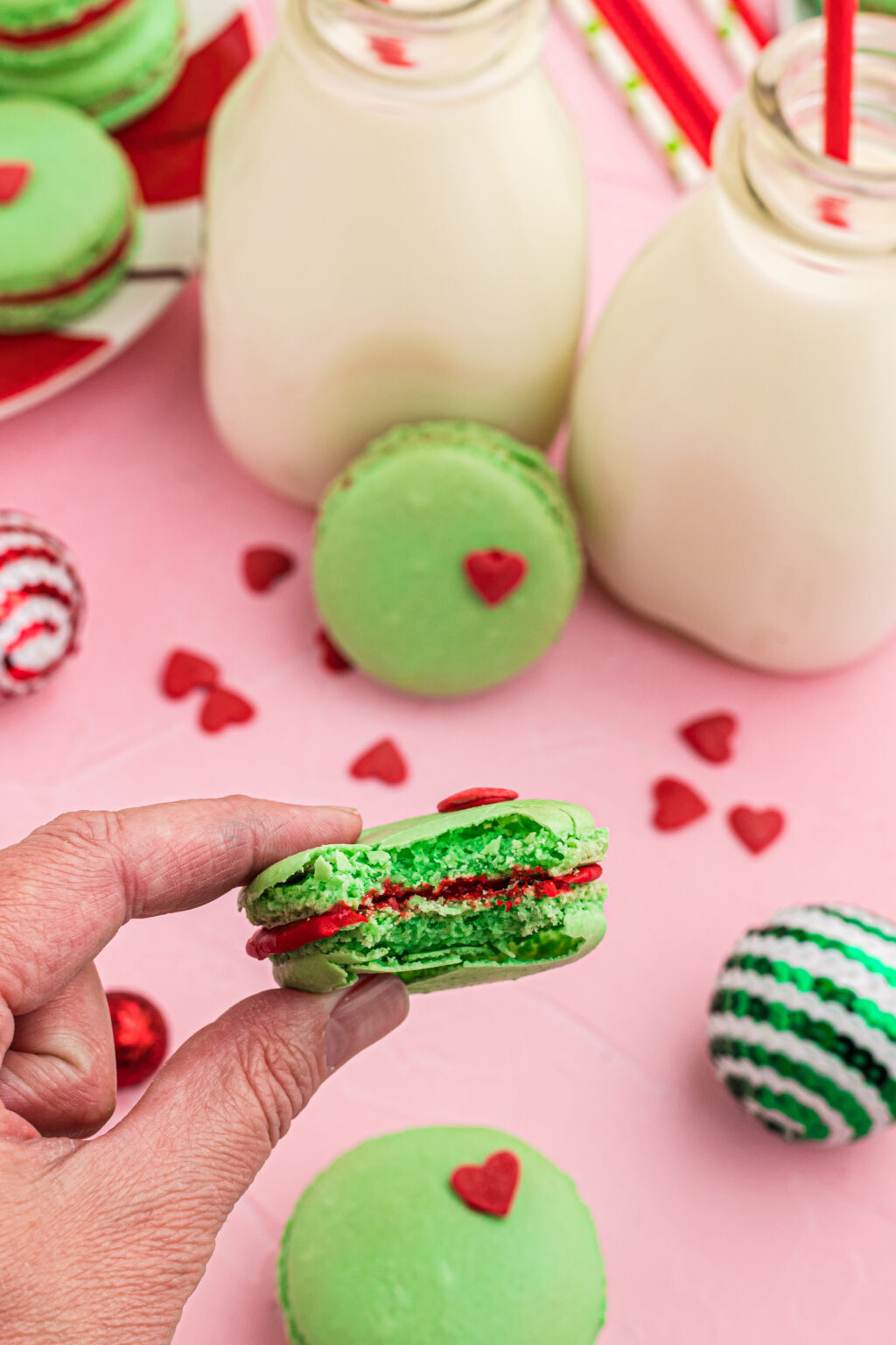 grinch macarons with bite taken out