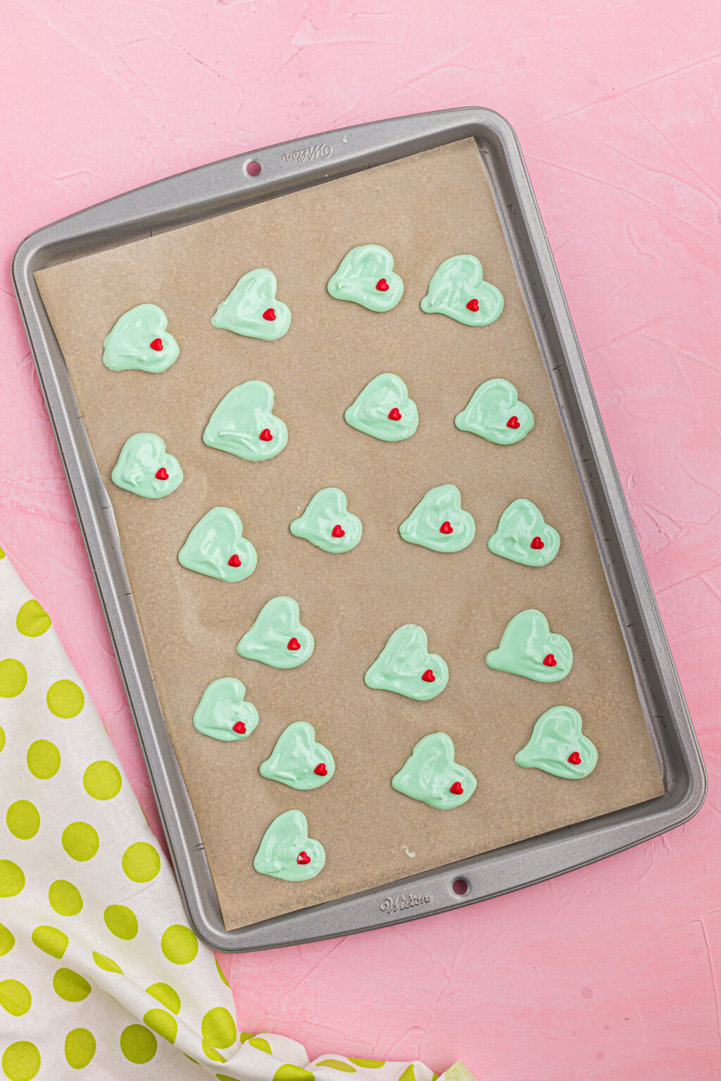 grinch meringue cookies on cookie sheet ready to be baked