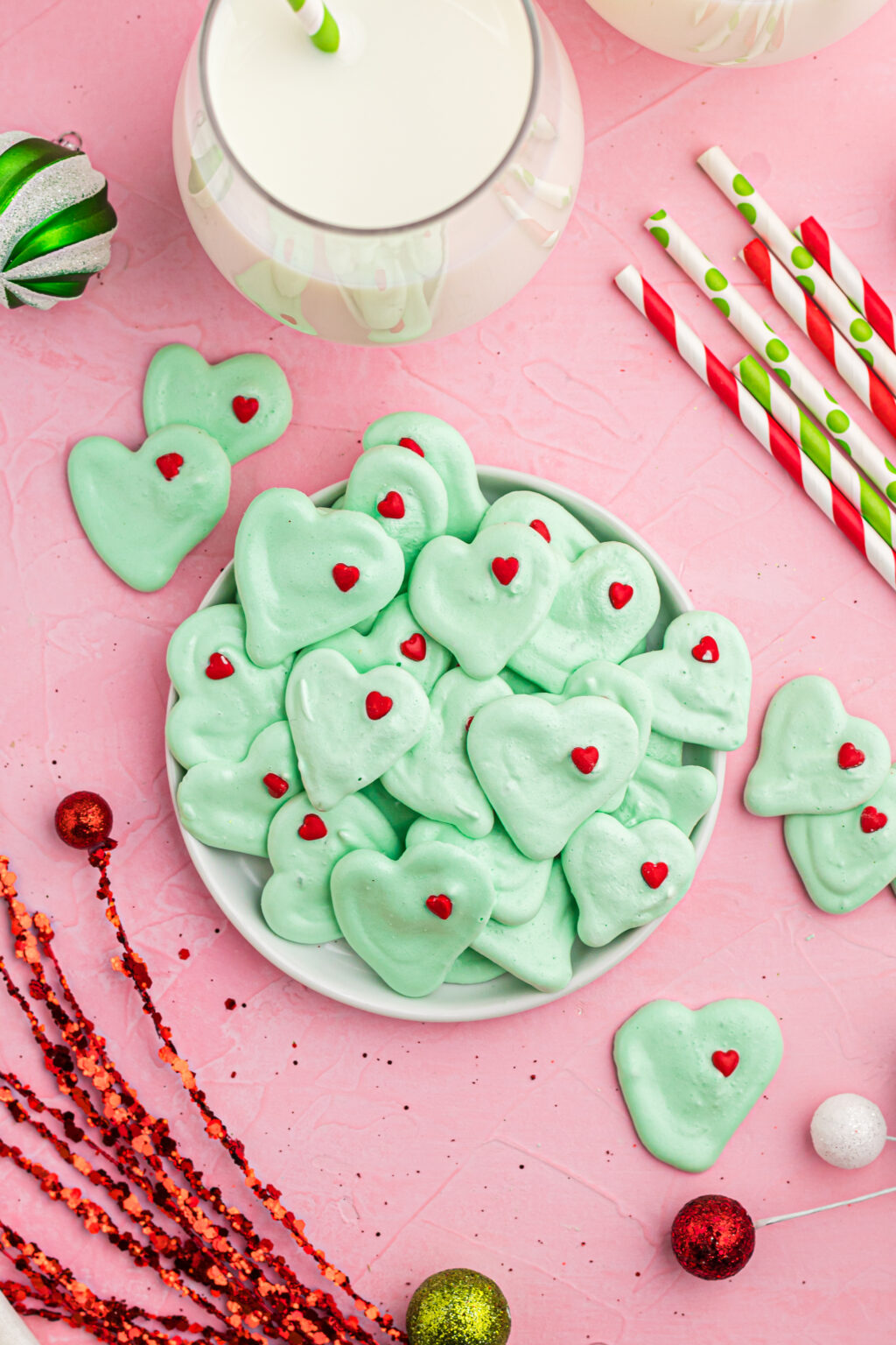 Grinch Meringue Cookies on plates