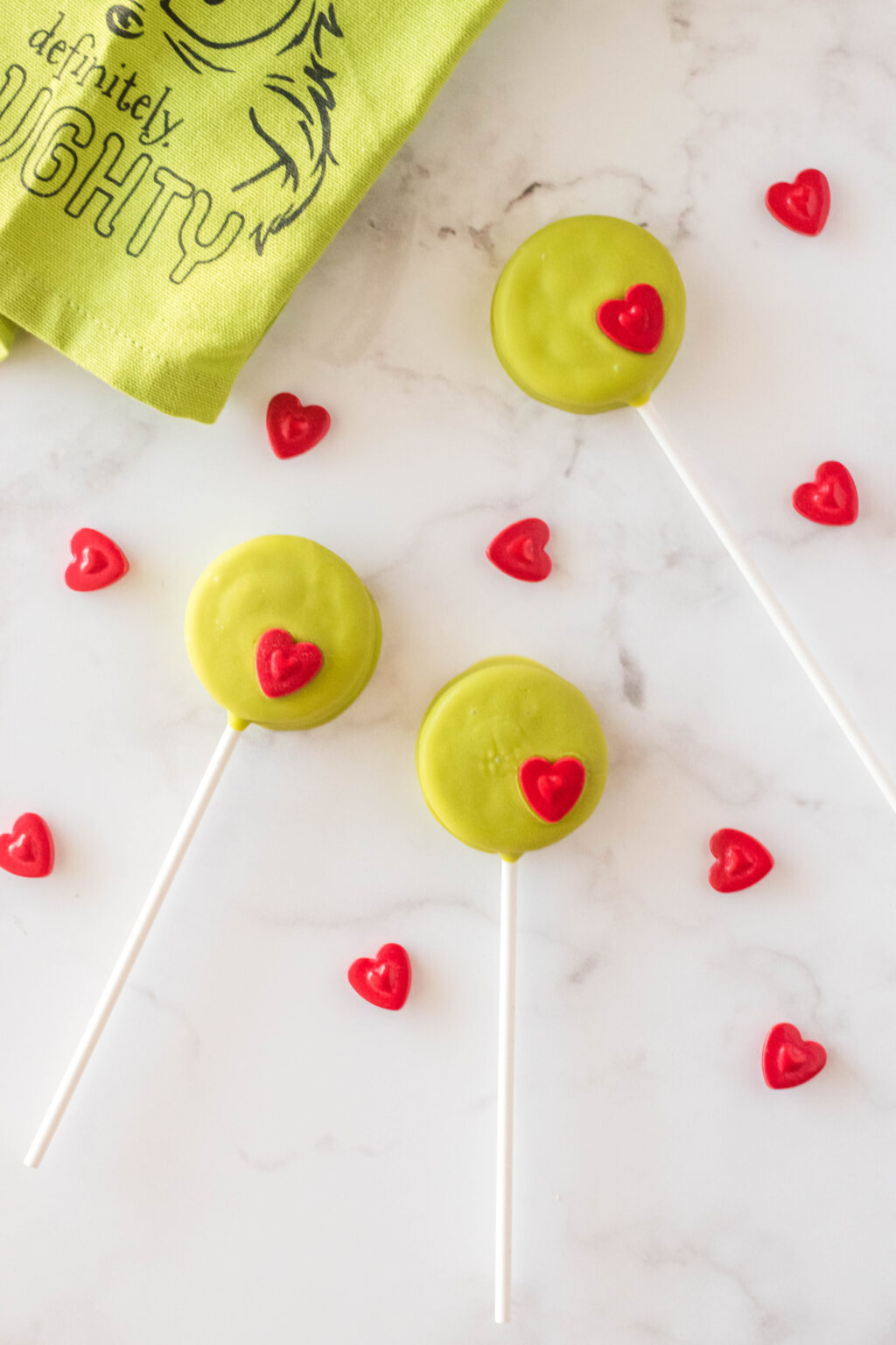 grinch oreo pops on table